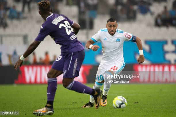 Olympique de Marseille's French forward Dimitri Payet vies with Toulouse's Swiss defender Francois Moubandje during the French L1 football match...