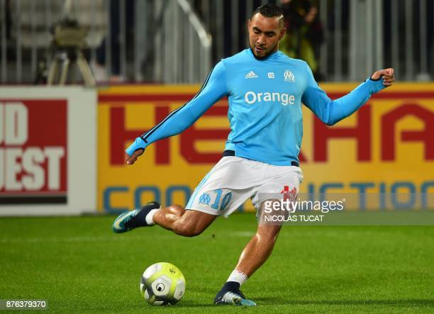 Olympique de Marseille's French forward Dimitri Payet warms up prior to the French L1 football match between Bordeaux and Marseille on November 19...