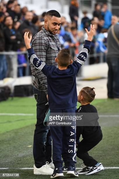 Olympique de Marseille's French forward Dimitri Payet with his children attends the French L1 football match between Olympique of Marseille and Caen...