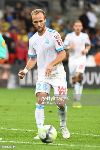 Olympique de Marseille's French forward Valere Germain runs with the ball during the French L1 football match between Olympique of Marseille and...