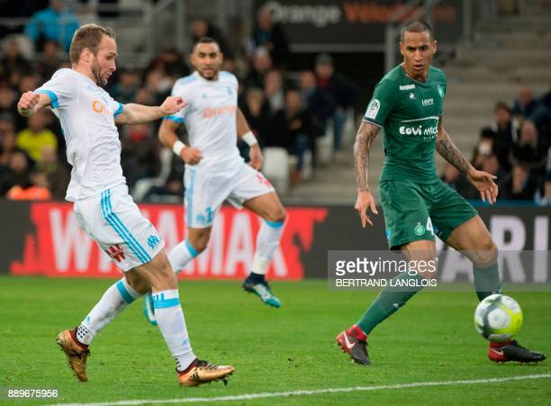 Olympique de Marseille's French forward Valere Germain scores despite SaintEtienne's French defender Leo Lacroix during the French L1 football match...
