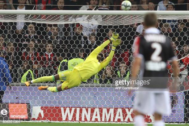Olympique de Marseille's French goalkeeper Steve Mandanda makes a save during the French L1 football match Nice vs Marseille on October 01 2017 at...