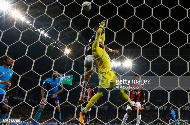 Olympique de Marseille's French goalkeeper Steve Mandanda makes a save during the French L1 football match Nice vs Marseille on October 1 2017 at the...