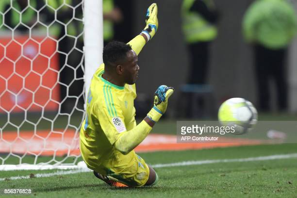 Olympique de Marseille's French goalkeeper Steve Mandanda stops a penalty during the French L1 football match between Nice and Marseille on October 1...