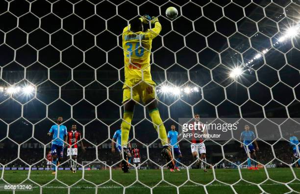 Olympique de Marseille's French goalkeeper Steve Mandanda stops a penalty during the French L1 football match Nice vs Marseille on October 1 2017 at...