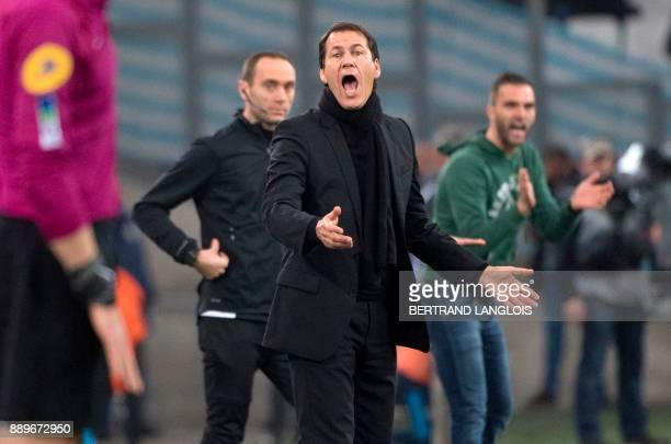 Olympique de Marseille's French head coach Rudi Garcia gestures next to SaintEtienne's Spanish head coach Julien Sable during the French L1 football...