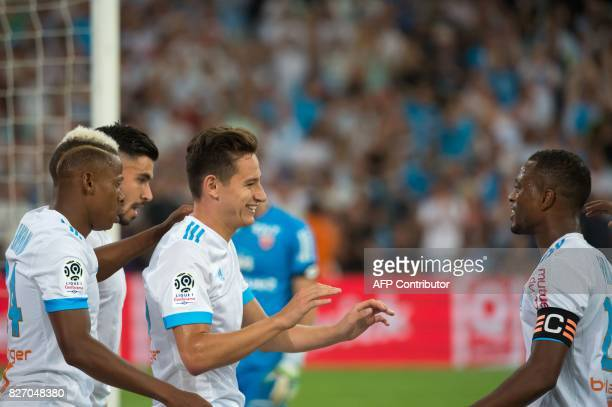 Olympique de Marseille's French midfielder Florian Thauvin celebrates after scoring a goal during the French L1 football match Olympique de Marseille...