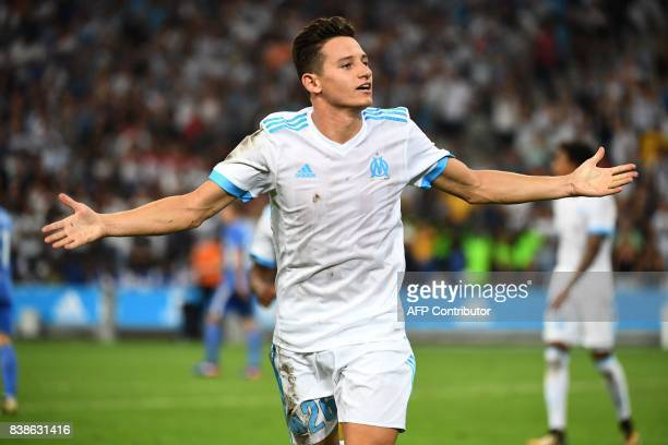 Olympique de Marseille's French midfielder Florian Thauvin celebrates after scoring his team's third goal during the UEFA Europa League playoff round...