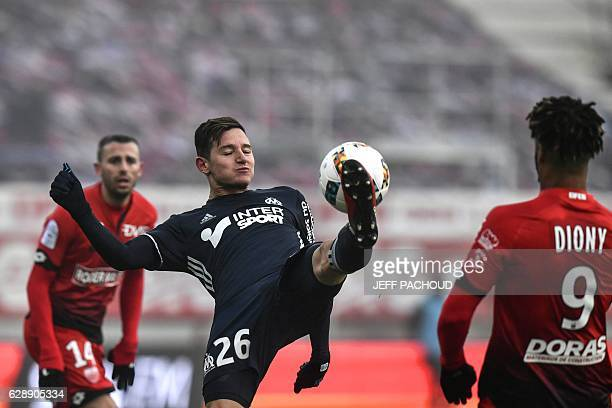 Olympique de Marseille's French midfielder Florian Thauvin controls the ball during the French L1 football match Dijon vs Marseille on December 10...