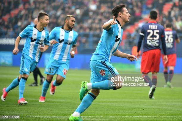 Olympique de Marseille's French midfielder Florian Thauvin reacts after scoring a goal during the French L1 football match between Caen and Marseille...