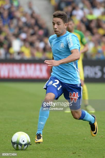 Olympique de Marseille's French midfielder Maxime Lopez runs with the ball during the French Ligue 1 football match between Nantes and Olympique de...