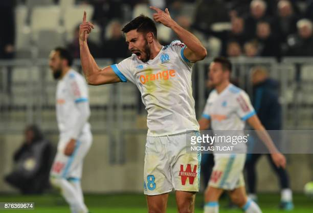 Olympique de Marseille's French midfielder Morgan Sanson celebrates after scoring the equalizer during the French Ligue 1 football match between...