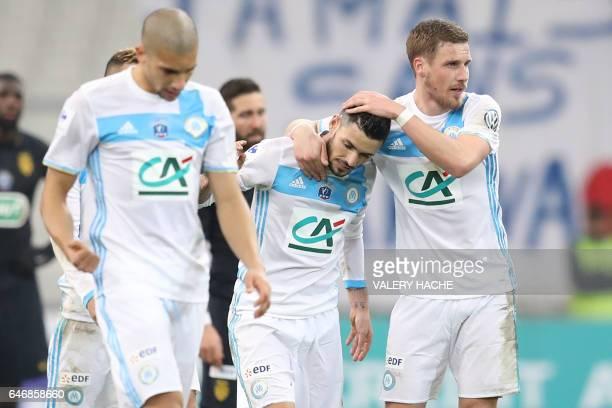 Olympique de Marseille's French midfielder Remy Cabella celebrates with Marseille's midfielder Gregory Sertic after scoring his team's third goal...