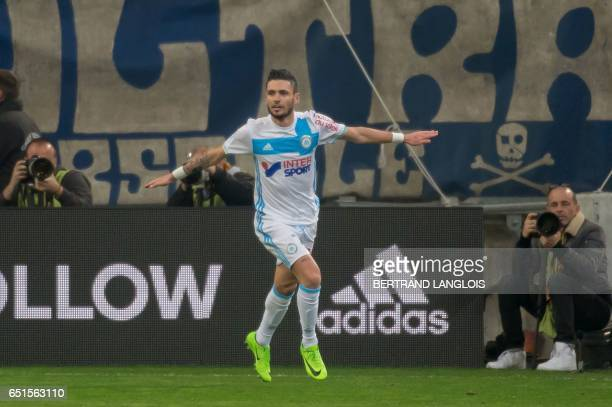 Olympique de Marseille's French midfielder Remy Cabella celebrates after scoring during the French L1 football match Olympique de Marseille vs Angers...