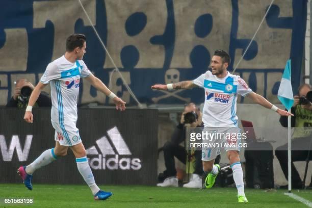 Olympique de Marseille's French midfielder Remy Cabella celebrates with Olympique de Marseille's French midfielder Florian Thauvin after scoring...