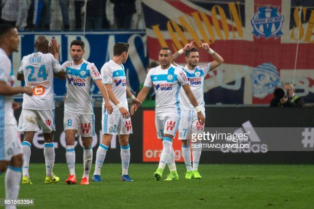 Olympique de Marseille's French midfielder Remy Cabella celebrates with teammates after scoring during the French L1 football match Olympique de...