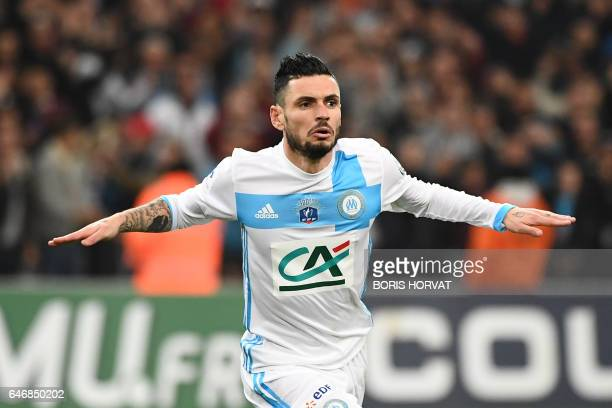 Olympique de Marseille's French midfielder Remy Cabella gestures as he celebrates after scoring a goal during the French Cup football match between...