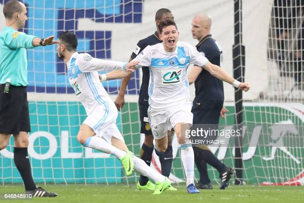 Olympique de Marseille's French midfielder Remy Cabella reacts after scoring a goal during the French Cup football match between Marseille and Monaco...