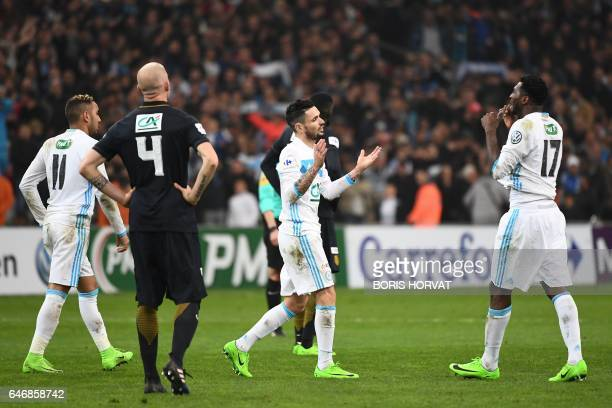Olympique de Marseille's French midfielder Remy Cabella reacts after scoring his team's third goal during the French Cup football match Marseille vs...