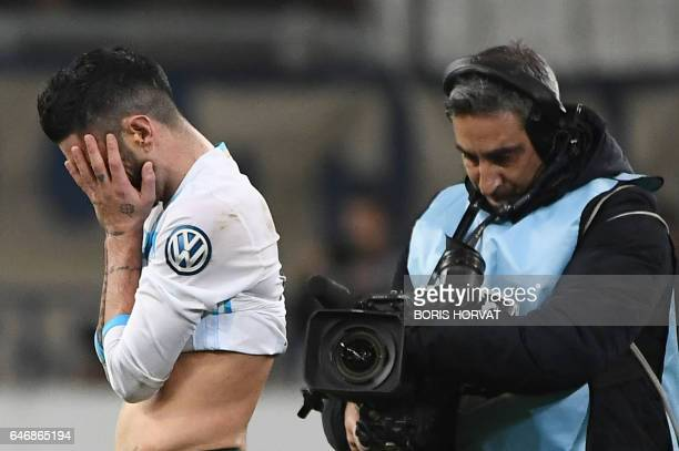Olympique de Marseille's French midfielder Remy Cabella reacts after Monaco won the French Cup football match Marseille vs Monaco on March 1 2017 at...