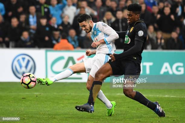 Olympique de Marseille's French midfielder Remy Cabella shoots to score his team's third goal during the French Cup football match Marseille vs...