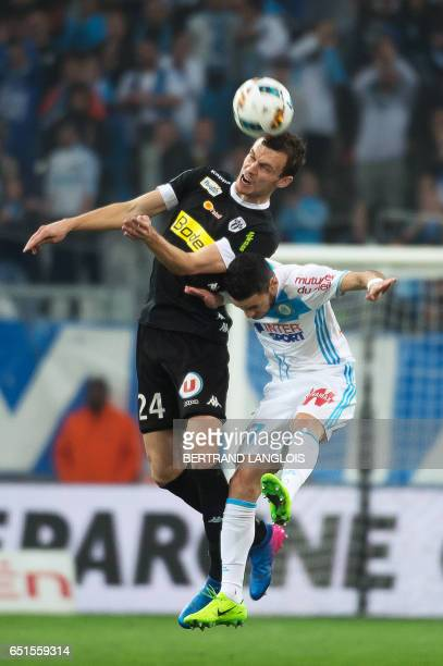 Olympique de Marseille's French midfielder Remy Cabella vies with Angers' French defender Romain Thomas during the French L1 football match between...
