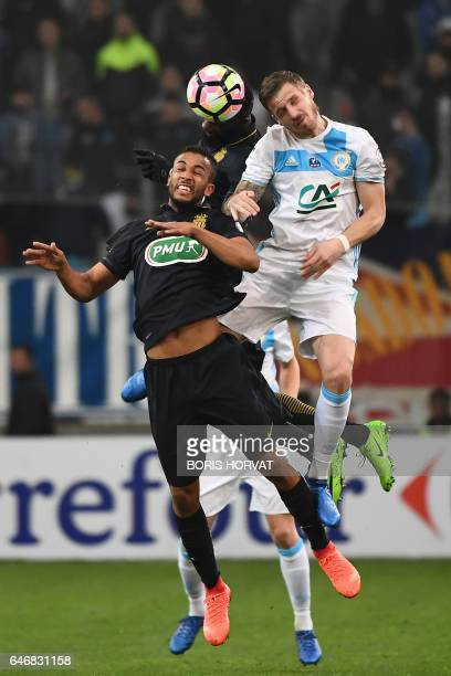 Olympique de Marseille's French midfielder William Vainqueur vies with Monaco's Brazilian defender Jorge during the French Cup football match between...
