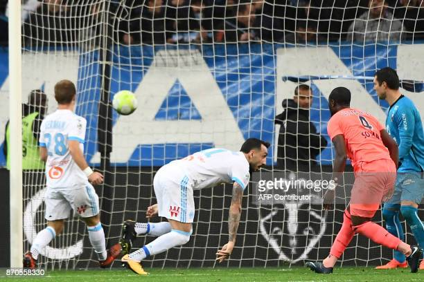 Olympique de Marseille's Greek forward Konstantinos Mitroglou scores the fourth goal during the French L1 football match between Olympique of...
