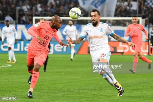 Olympique de Marseille's Greek forward Konstantinos Mitroglou vies with Caen's FrenchGuinean midfielder Baissama Sankoh during the French L1 football...
