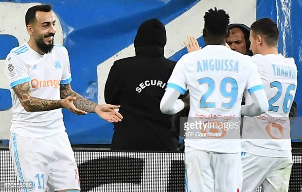 Olympique de Marseille's Greek forward Konstantinos Mitroglou celebrates with teammates after scoring the fourth goal during the French L1 football...
