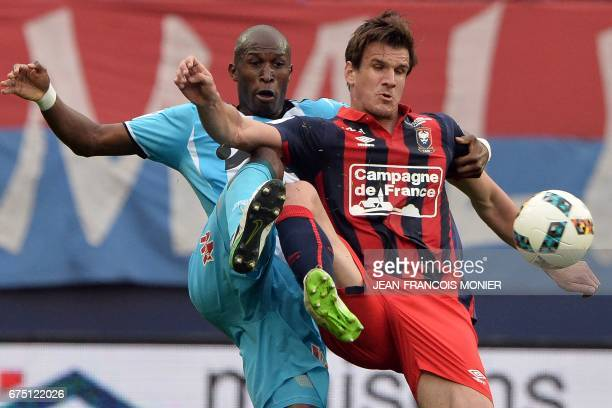 Olympique de Marseille's Japanese defender Hiroki Sakai vies for the ball with Caen's Croatian forward Ivan Santini during the French L1 football...