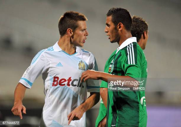Olympique de Marseille's Jeremy Morel and St Etienne's Idriss Saadi argue as tempers flare between the two sides