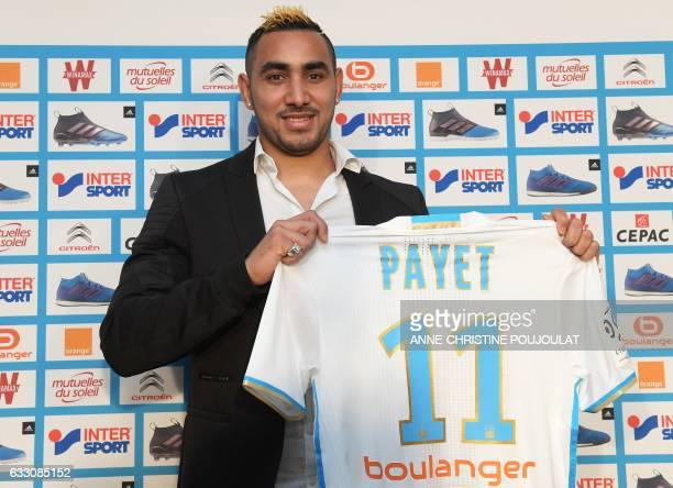 Olympique de Marseille's new forward Dimitri Payet poses with his jersey during a press conference on January 30 2017 at RobertLouis Dreyfus Stadium...