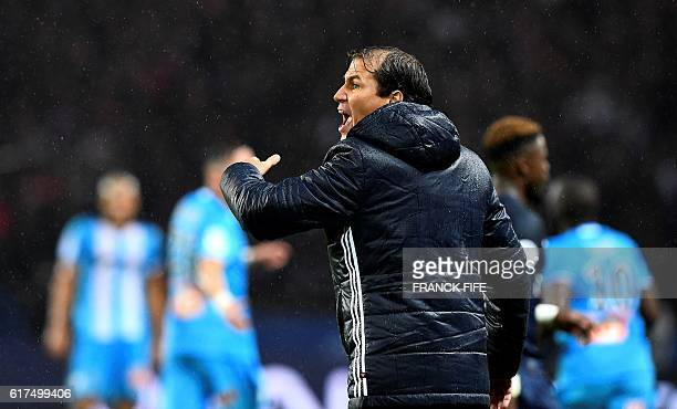 Olympique de Marseille's new French head coach Rudi Garcia gestures during the French L1 football match between Paris SaintGermain and Olympique of...