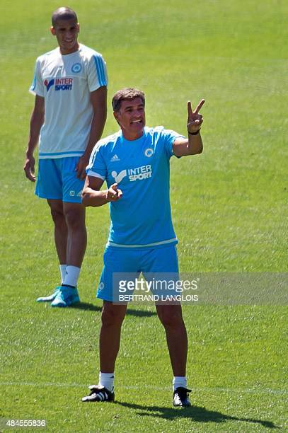Olympique de Marseille's new Spanish head coach Jose Miguel Gonzalez Martin del Campo aka Michel gestures during his first training session at the...
