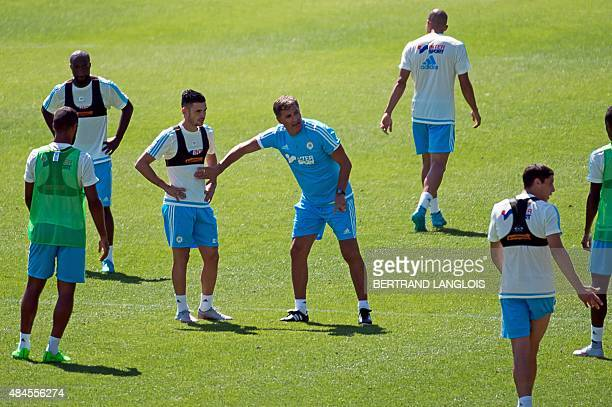 Olympique de Marseille's new Spanish head coach Jose Miguel Gonzalez Martin del Campo aka Michel gestures next to Marseille's new French midfielder...