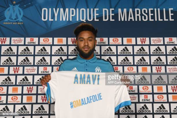 Olympique de Marseille's newly recruited player Jordan Amavi holds his new jersey during his official presentation on August 10 2017 at the...