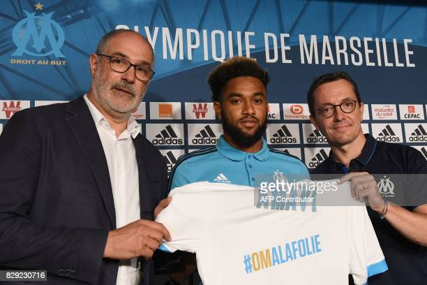 Olympique de Marseille's newly recruited player Jordan Amavi holds his new jersey next to Olympique de Marseille French president JacquesHenri Eyraud...