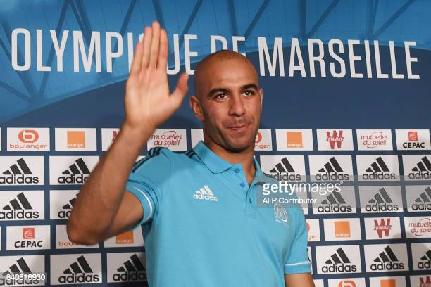 Olympique de Marseille's newly recruited player Tunisien defender Aymen Abdennour waves during his official presentation on August 30 2017 at the...