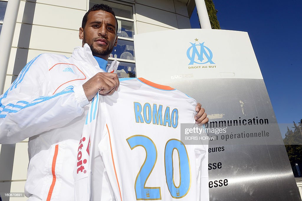 Olympique de Marseille's newly-recruited French-born Togolese midfielder Jacques-Alaixys Romao poses with his new jersey after a press conference as part of his official presentation on February 07, 2013 at the Commanderie stadium in Marseille. Lorient's former midfielder Romao, 29, signed a contract, reported to be for three years and a half, with Marseille.