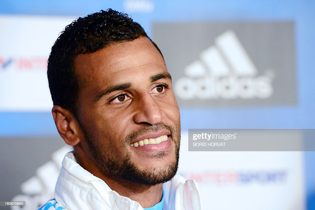Olympique de Marseille's newly-recruited French-born Togolese midfielder Jacques-Alaixys Romao poses during a press conference as part of his official presentation on February 07, 2013 at the Commanderie stadium in Marseille. Lorient's former midfielder Romao, 29, signed a contract, reported to be for three years and a half, with Marseille.