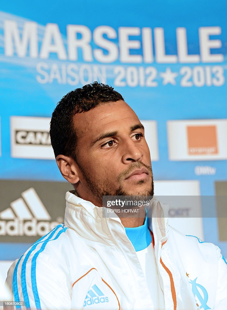 Olympique de Marseille's newly-recruited French-born Togolese midfielder Jacques-Alaixys Romao poses during a press conference as part of his official presentation on February 07, 2013 at the Commanderie stadium in Marseille. Lorient's former midfielder Romao, 29, signed a contract, reported to be for three years and a half, with Marseille. AFP PHOTO / BORIS HORVAT