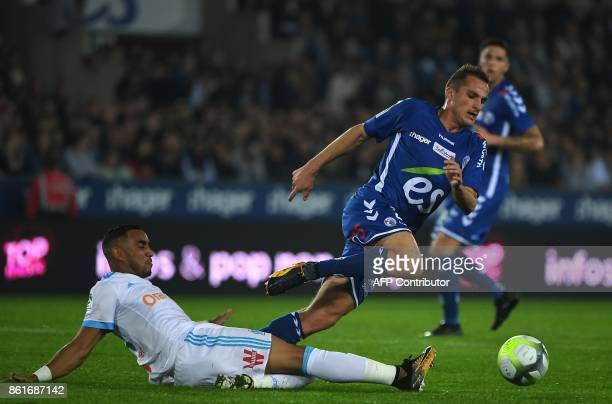 Olympique de Marseille's Olympique de Marseille's French forward Dimitri Payet vies with Strasbourg's French midfielder Dimitri Lienard during the...