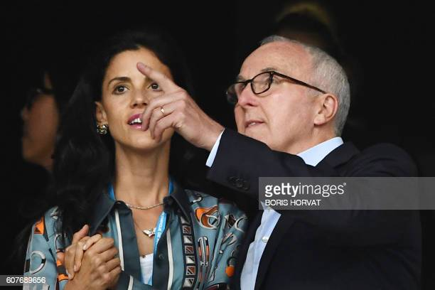 Olympique de Marseille's owner Frank McCourt with his wife Monica gestures before the French L1 football match Olympique of Marseille versus Lyon at...