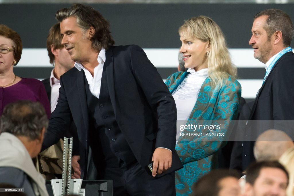 Olympique de Marseille's owner Margarita Louis-Dreyfus (2ndR) and OM's president Vincent Labrune (2ndL) stand prior to the French L1 football match Olympique de Marseille vs Paris Saint-Germain on October 6, 2013 at the Velodrome stadium in Marseille, southern France. AFP PHOTO / BERTRAND LANGLOIS