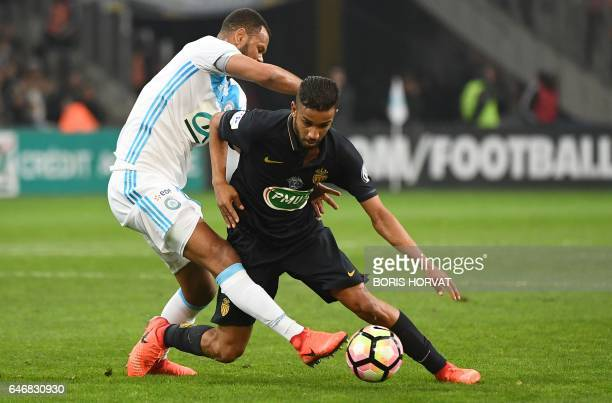 Olympique de Marseille's Portuguese defender Rolando Jorge Pires da Fonseca vies with Monaco's Brazilian defender Jorge during the French Cup...