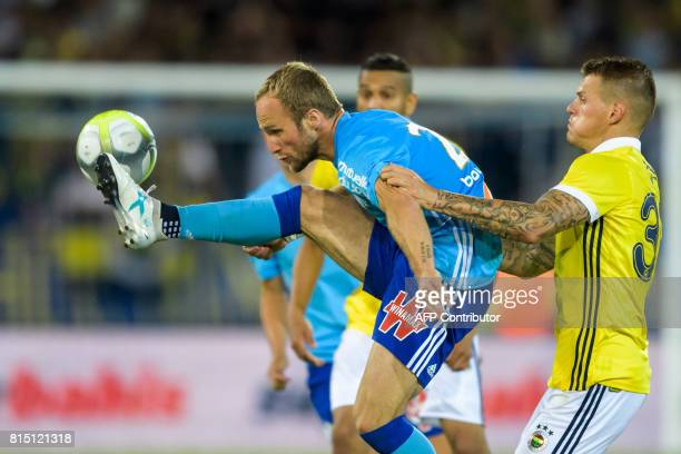 Olympique de Marseille's Valere Germain controls the ball next to Fenerbahce's Martin Skirtel during a friendly football match between Olympique de...