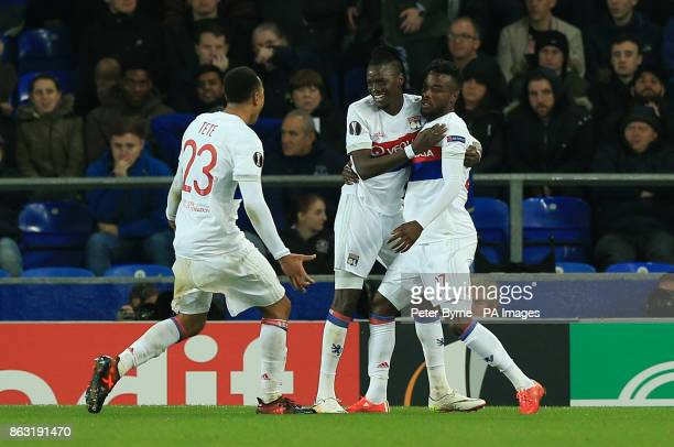 Olympique Lyonnais' Bertrand Traore celebrates scoring his side's second goal of the game with teammates Kenny Tete and Maxwel Cornet during the UEFA...
