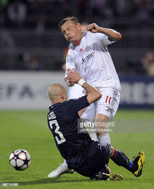 Olympique Lyonnais' Brazilian defender Cris intercepts Bayern Munich's Croatian striker Ivica Olic during the second leg UEFA Champions League...
