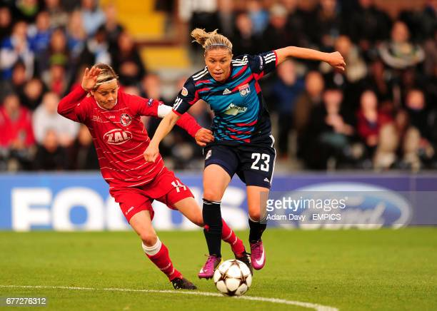 Olympique Lyonnais' Camille Abily and FFC Turbine Potsdam's Jennifer Zietz battle for the ball